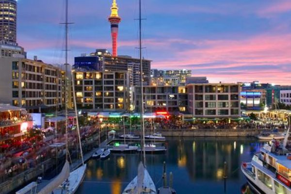 Exciting view of Auckland with glittering ships and buildings with caravan for rent