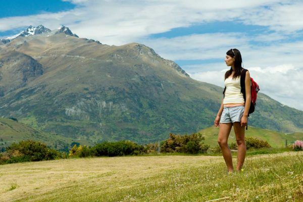 Two girls enjoying the scenic beauty of nature with caravan for rent