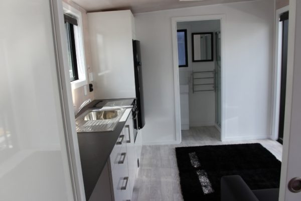 tiny home view kitchen to ensuite Tiny homes